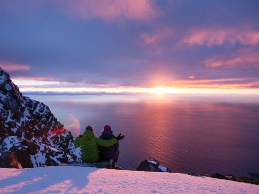 Skiers in Lofoten watching sunset